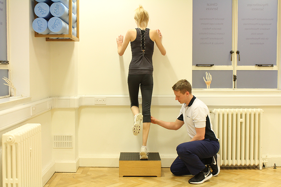 Chiropody specialist working with athletics client.