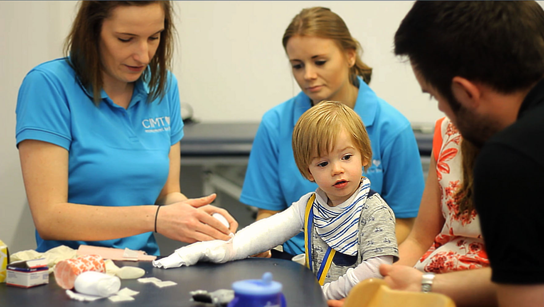 Parents with son during CIMT therapy.