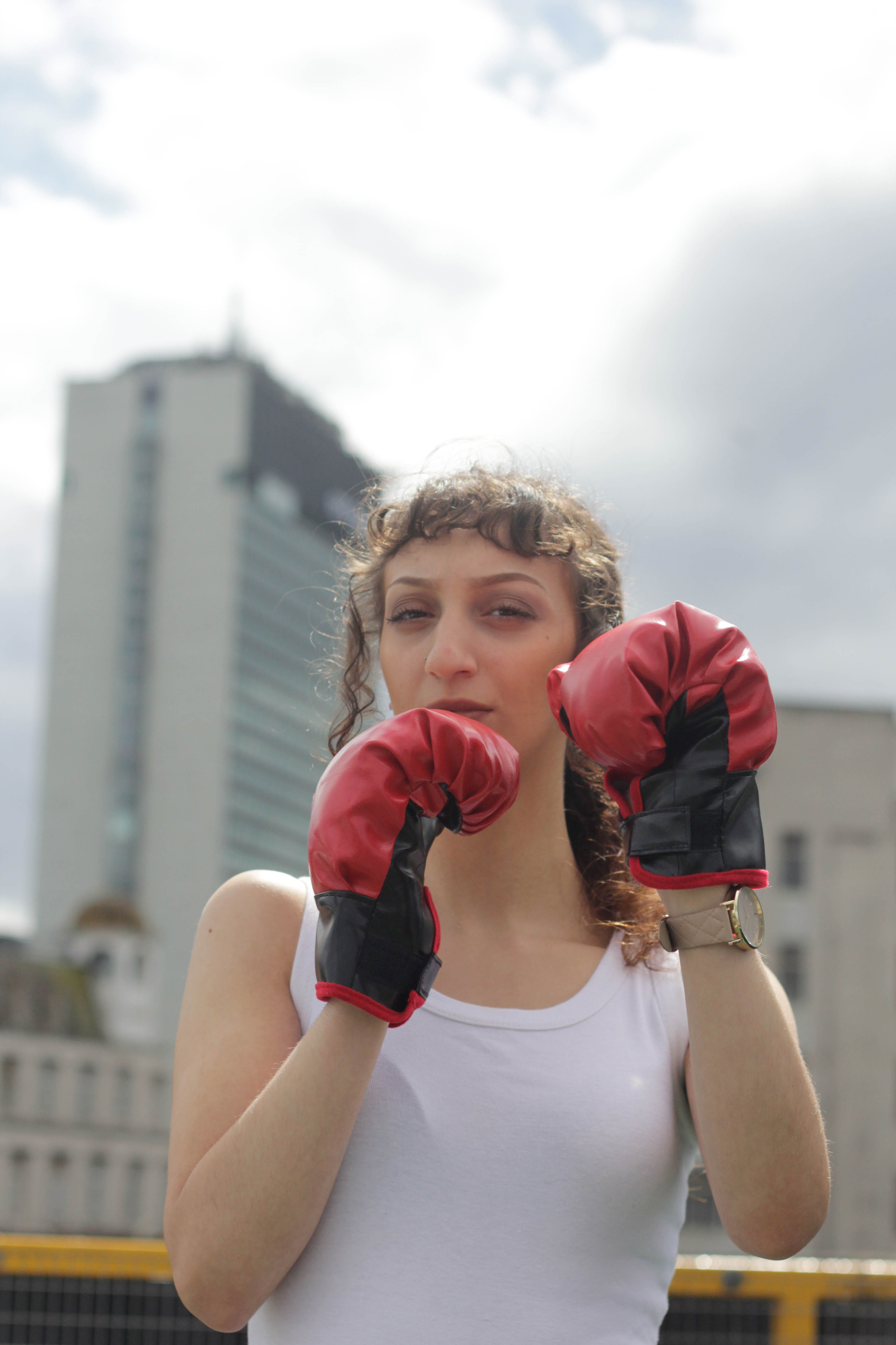 Shot of face with boxing gloves.