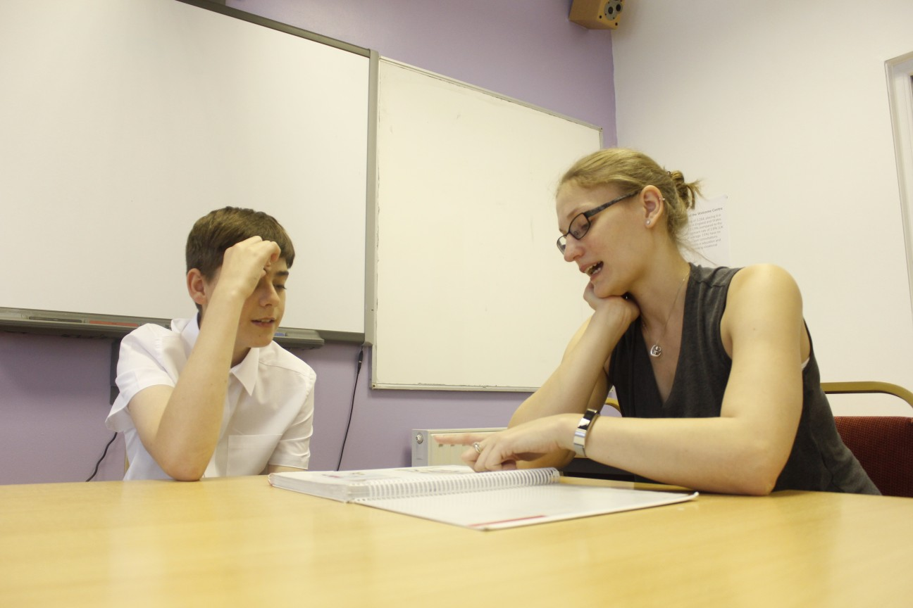 HSR Therapist Sarah Ward working with young boy.