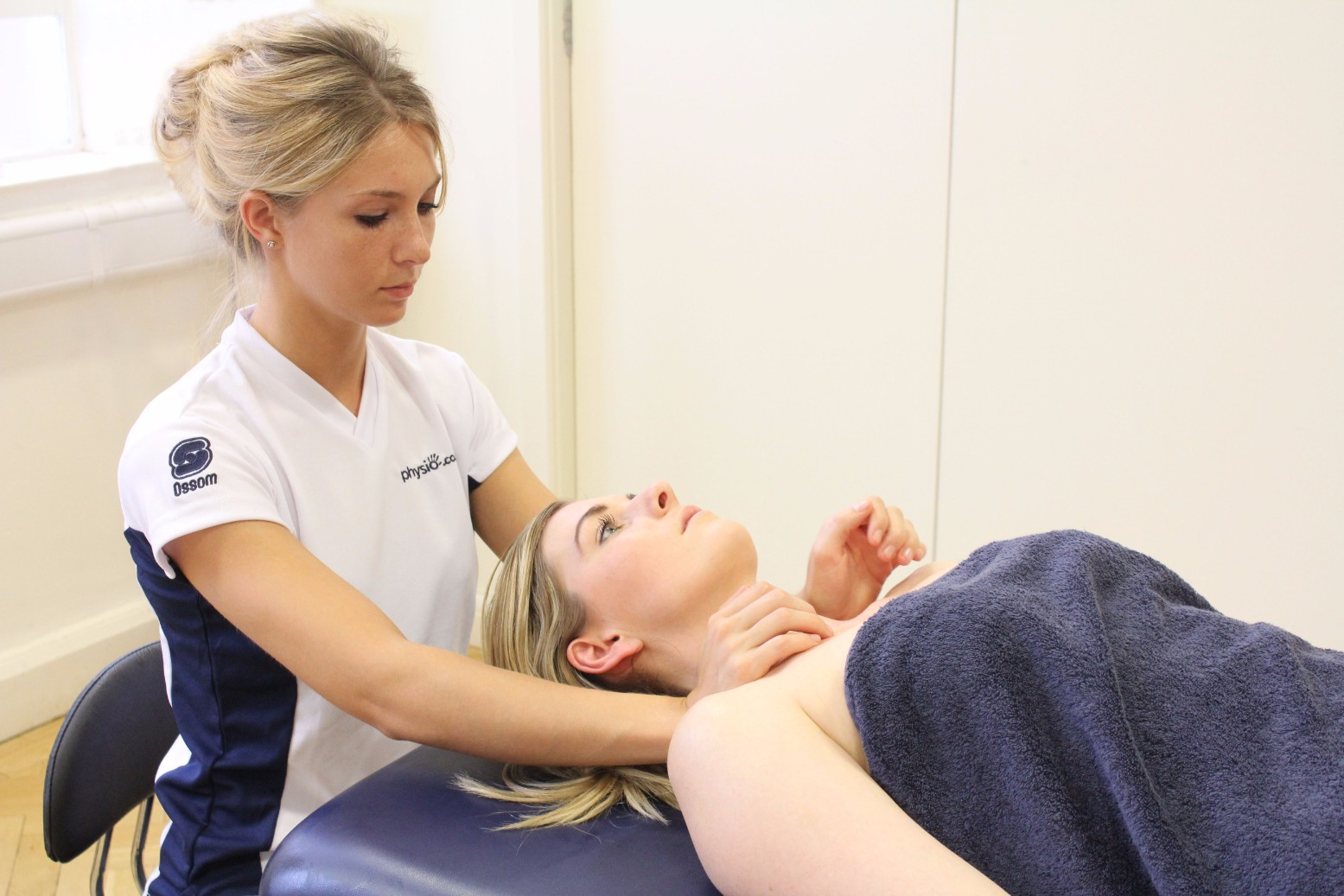 Katie delivering a sports massage to a patient.