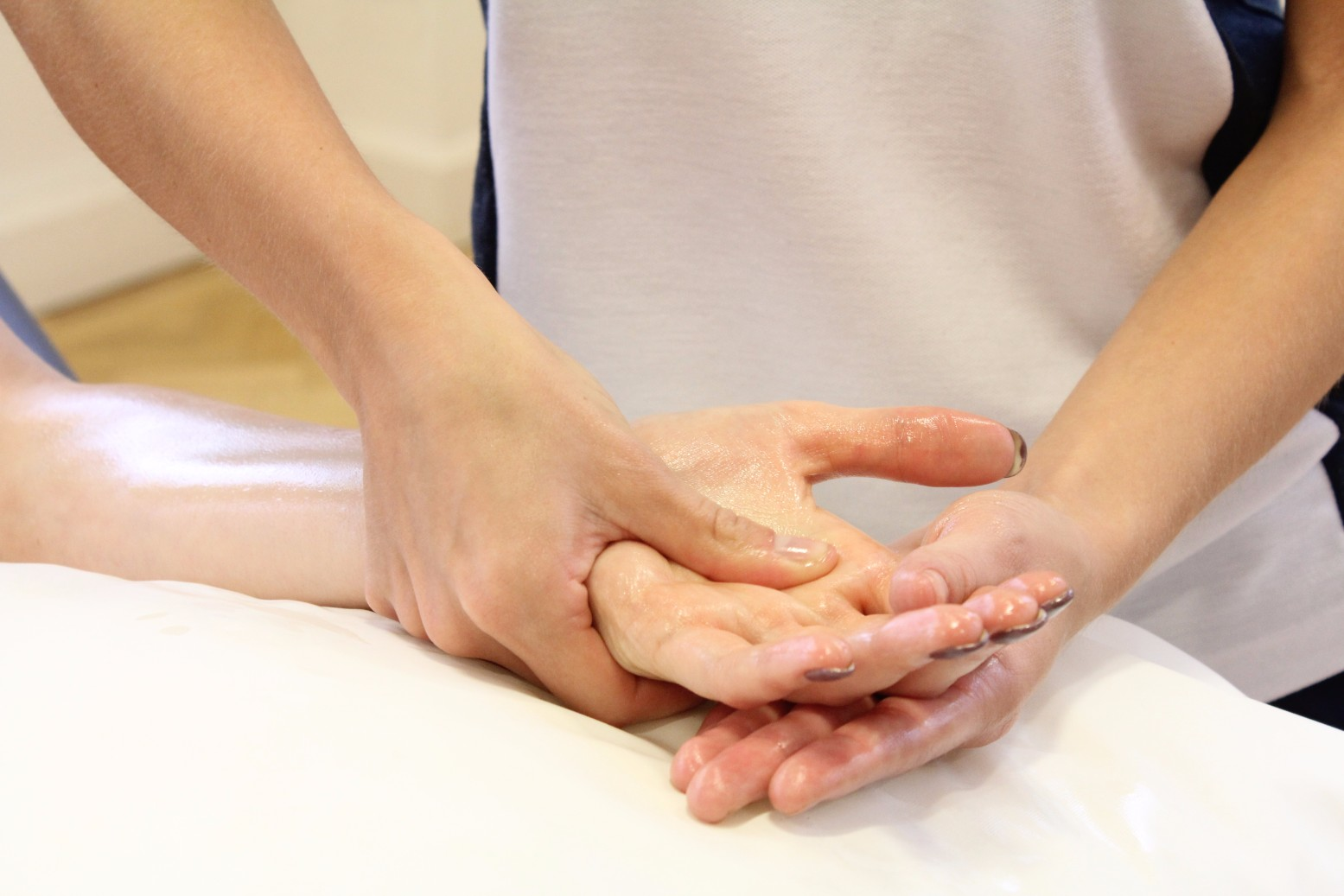 Therapist rubbing patient's palm.