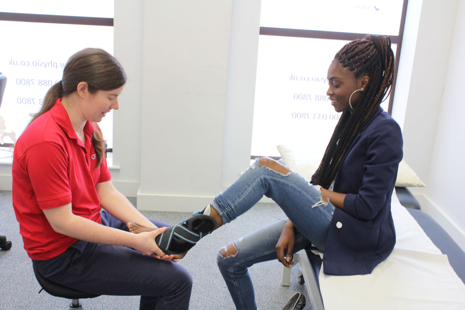 Orthotics professional holding patient in ankle support.