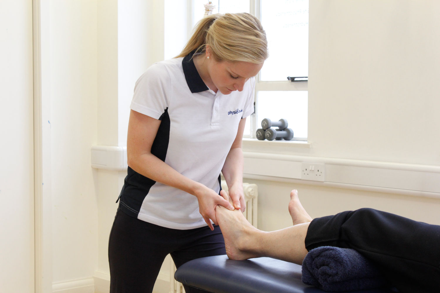 Patient receiving physiotherapy.