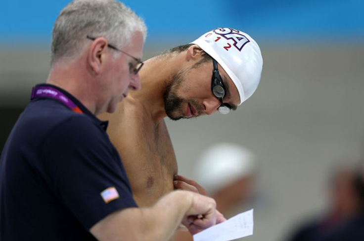 Swimmer looking at coach's notes.